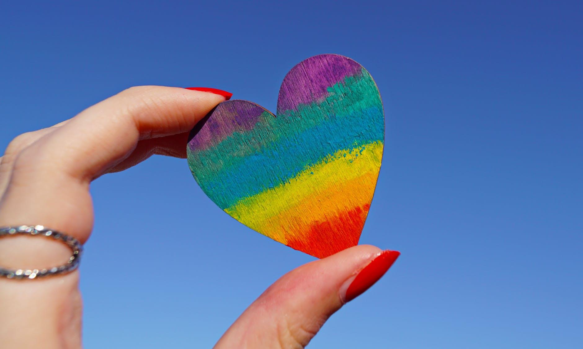 person holding multicolored heart decor