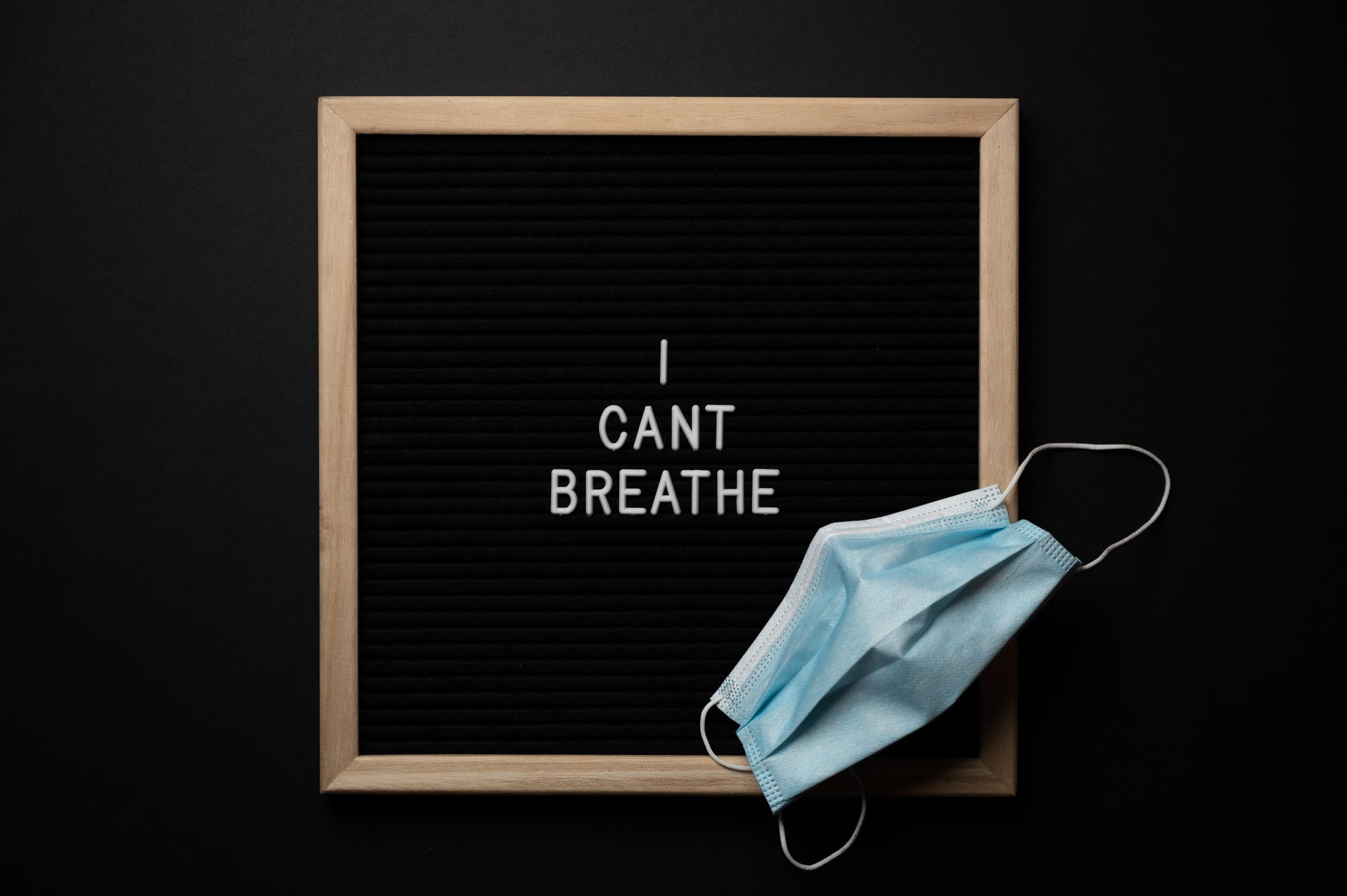 sterile mask on chalkboard with inscription on black background