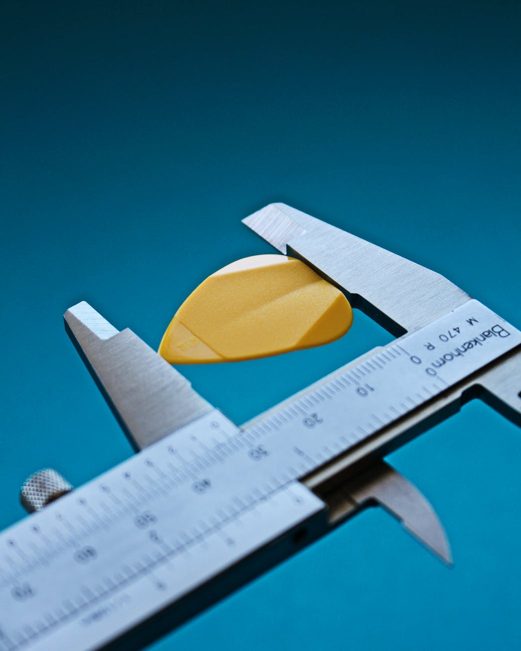 measuring guitar pick