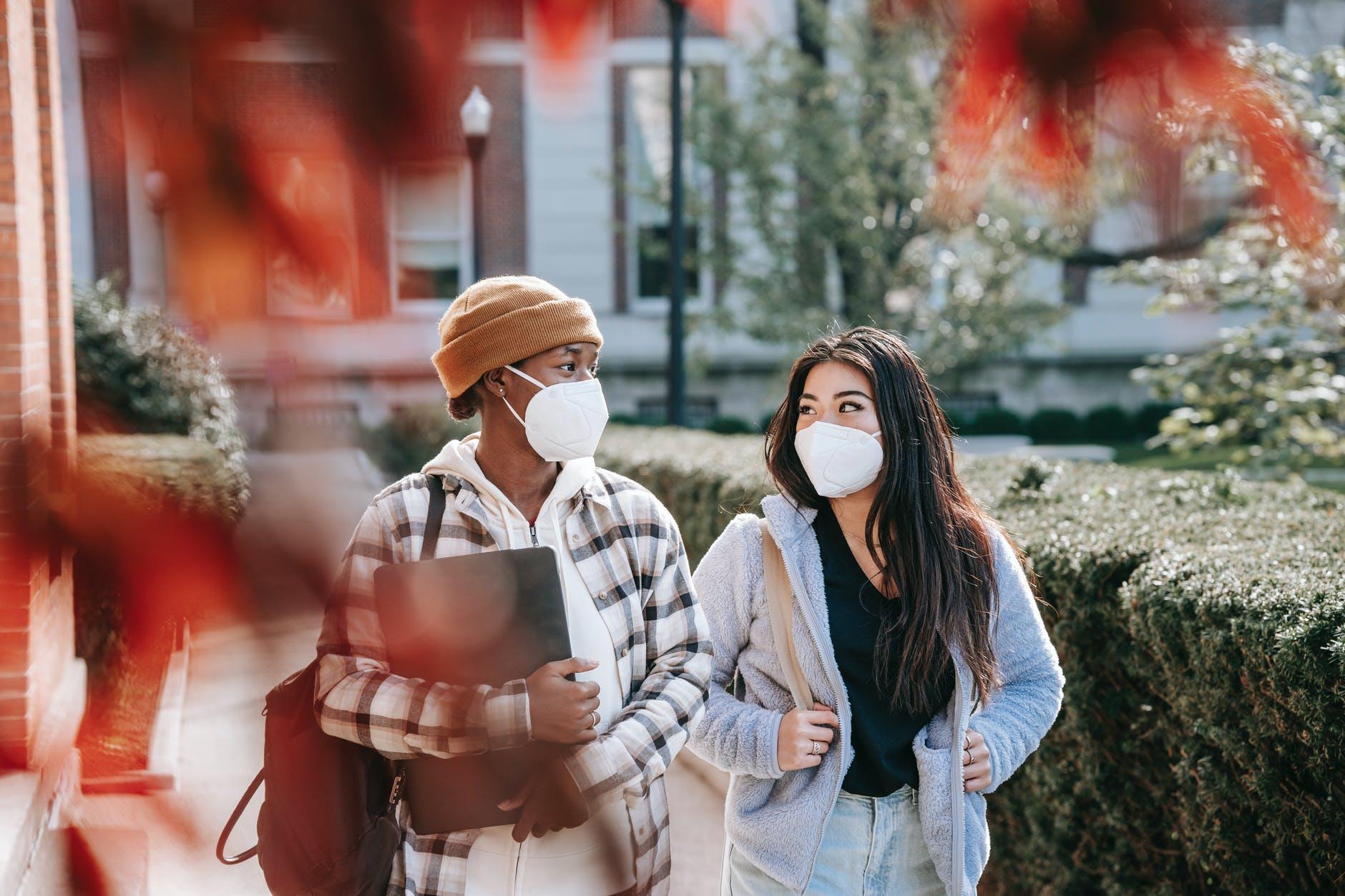happy multiethnic women walking in park