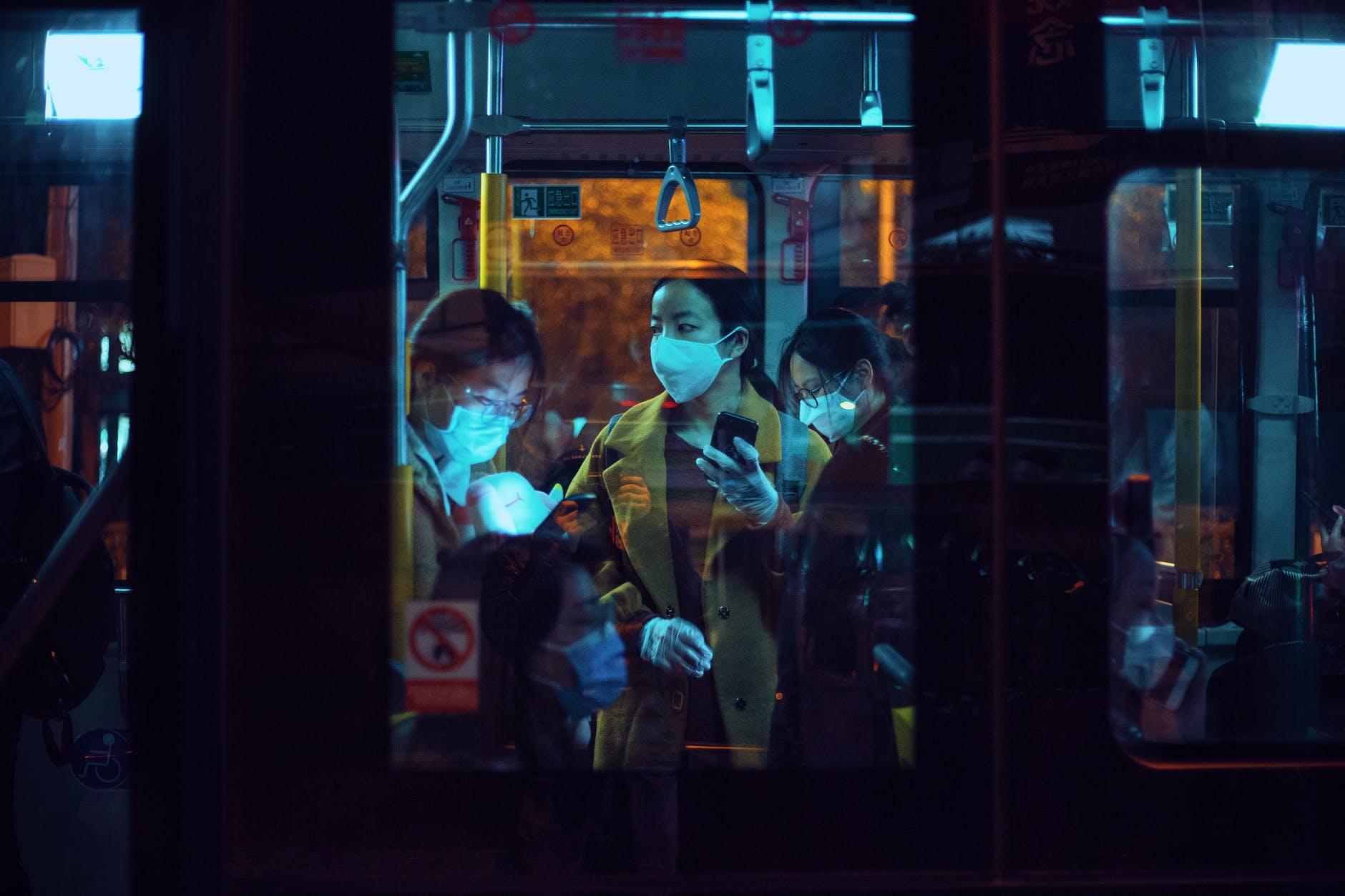 people inside a bus wearing masks