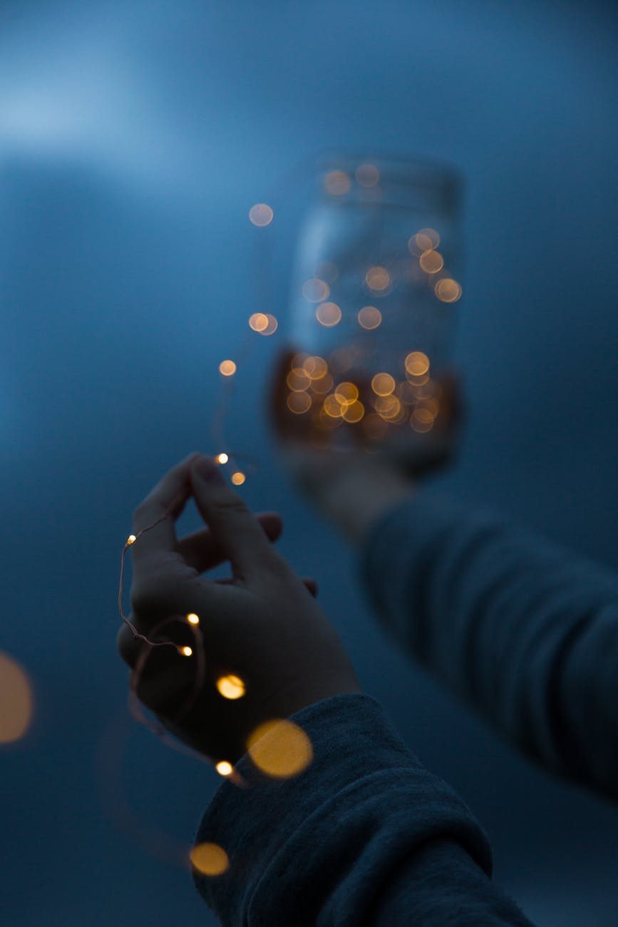 woman holding a yellow string light