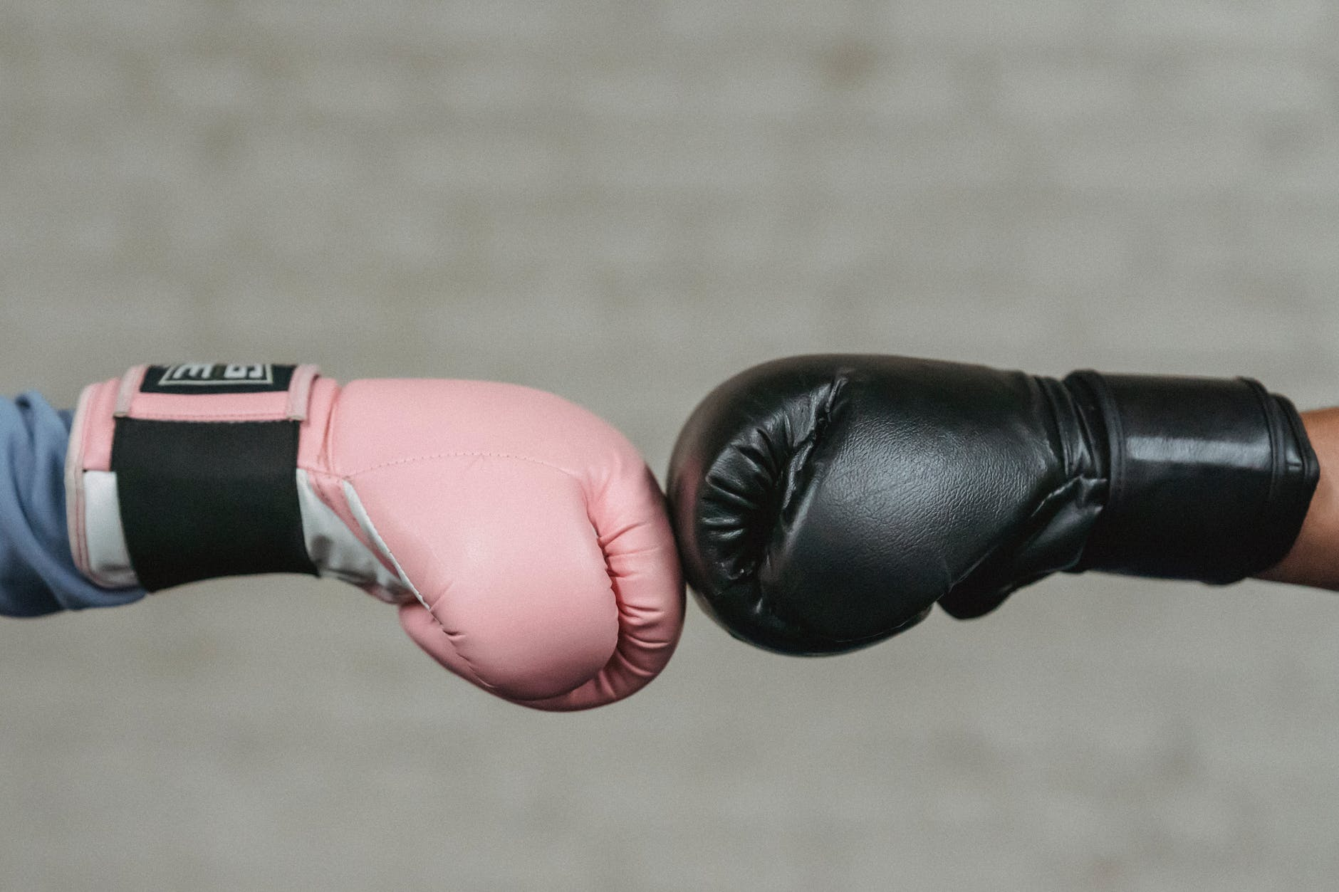 anonymous fighters bumping fists before boxing