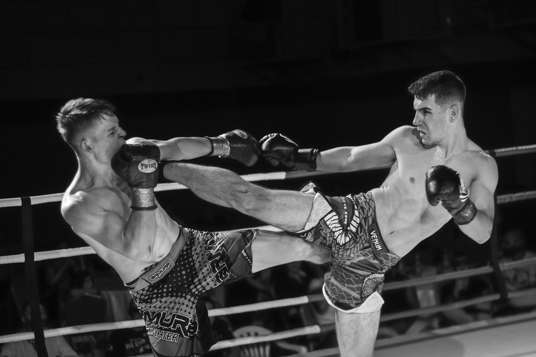 men fighting in the ring