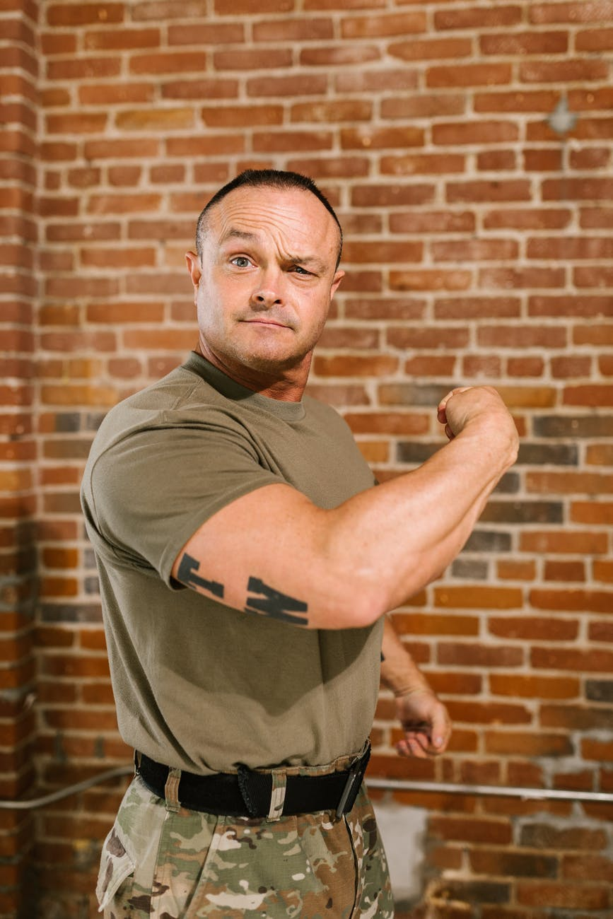 photo of soldier flexing his muscles